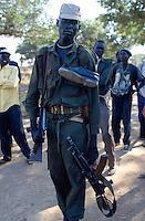 Sudan. South Sudan. Bahr El Ghazal. Malval Akon. SPLA (Sudanese People Liberation Army) soldier from the dinka tribe. © 1999 Didier Ruef