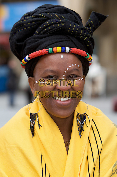 "TANDILE MANDELA .Photo opportunity for the musical ""Mandela"",  City Hall, Munich, Germany..March 9th, 2009.headshot portrait red earrings black yellow hat make-up make up paint .CAP/PPG/JH.©Jens Hartmann/People Picture/Capital Pictures"