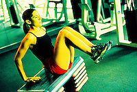 Young female working out.