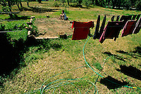 Woman resting while putting in garden with wash on clothes line, Buena Vista Colorado, <br /> MODEL RELEASED