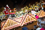 Santa Clause makes a grand entrance during the parade on a sleigh with his reindeer.