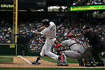 Seattle Mariners'  Seth Smith hits a triple to left field against the Los Angeles Angels in the season home opener April 6, 2015 at Safeco Field in Seattle.  The Mariners beat the Angels 4-1.    ©2015. Jim Bryant Photo. ALL RIGHTS RESERVED.