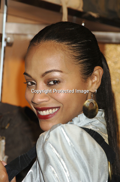 Zoe Saldana ..at a party to unveil a new line of leather handbags and belts for Spring 2006 by Steve Madden in partnership with Daniel M. Friedman & Associates on November 9, 2005 at the Daniel M. Friedman Showroom. ..Photo by Robin Platzer, Twin Images