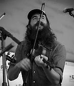 Ferd Moyse, IV of the Hacksaw Boys performs at Kingman Island Bluegrass festival.
