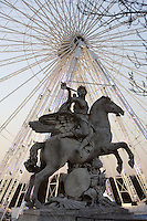 """""""La renommée montée sur Pegase"""", marble, 1668-1702, equestrian statue by Antoine Coysevox, Lyon 1640 - Paris 1720, placed at the Tuileries in 1719, exposed at Louvre Museum, great wheel of La Concorde in the background, Paris, France Picture by Manuel Cohen"""