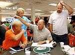Teachers at Lely High School work at a trivia game about there own school during teacher orientation before school starts in Naples Florida. Erik Kellar