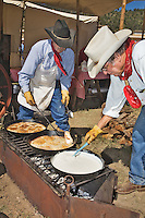 The 21st annual Lincoln County Cowboy Symposium was held in October 2010 at the Ruidoso Downs Racetrack in Ruidoso, New Mexico.  The Rockin Dubya crew  from Llano,Texas, work on a batch of chicken fried steak and gravy.
