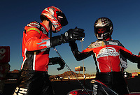 Oct. 30, 2011; Las Vegas, NV, USA: NHRA pro stock motorcycle rider Eddie Krawiec (right) is congratulated by teammate Andrew Hines after winning the Big O Tires Nationals at The Strip at Las Vegas Motor Speedway. Mandatory Credit: Mark J. Rebilas-