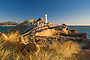 Rocky cliffs and Castlepoint lighthouse, Wairarapa, New Zealand