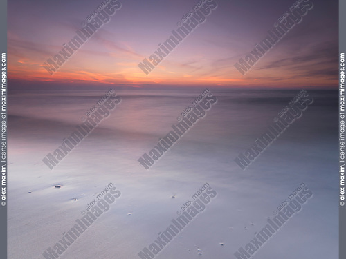 Peaceful sunset scenery with smooth calm water at lake Huron, Pinery Provincial Park, Grand Bend, Ontario, Canada.