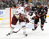 Brian Gibbons (BC - 17), Drew Ellement (Northeastern - 2) - The Boston College Eagles defeated the Northeastern University Huskies 5-4 in their Hockey East Semi-Final on Friday, March 18, 2011, at TD Garden in Boston, Massachusetts.
