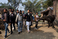 "Minister of Legislative Assembly, Ritesh Pandey, 30, campaigns door-to-door in rural villages with a crowd of supporters chanting slogans such as ""long live Ritesh Pandey"" and ""press the button, decide the elephant (symbol)"" in Ajanpara, Ambedkar Nagar, Uttar Pradesh, India, on 21st January, 2012. Returning 1.5 years ago after almost 10 years abroad, Pandey is contesting on behalf of the Bahujan Samaj Party (BSP), a party that is based on its appeal to Dalit (the lowest Hindu caste) voters. Party leader Mayawati, herself a Dalit, has recently been giving out more tickets to muslims and high caste candidates in an attempt to woo a larger spectrum of voters in Uttar Pradesh, a Bellwether state. Photo by Suzanne Lee for The National (online byline: Photo by Szu for The National)"