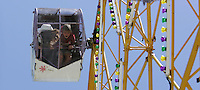 Shelby Swartz, 15, and Hunter Swartz, 12, ride the ferris wheel at the carnival during the Houby Days Festival in Czech Village on Saturday, May 16, 2009 (Chris Mackler/The Gazette).