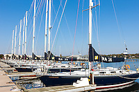 """US Naval Academy 44 foot sail training craft (Navy 44s) including """"Fearless"""", """"Valiant"""", and """"Audacious"""" sit at anchor in Santee Basin at the USNA Sailing Center awaiting their next training mission.  The US Naval Academy is located in Annapolis, Maryland."""