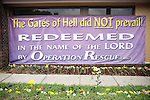 "At the Operation Rescue's office, a banner reads: ""The gates of Hell did NOT prevail! Redeemed in the name of the LORD by OPERATION RESCUE"".  Wichita, KS. 2009, June 20th. Photo: Antoine Doyen"