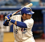 26 May 2002: Montreal Expos shortstop Orlando Cabrara at bat when the Expos held their first of two retrospective game events, turning back the clock to the 1970s at Olympic Stadium, in Montreal, Quebec, Canada. ..Mandatory Photo Credit: Ed Wolfstein Photo