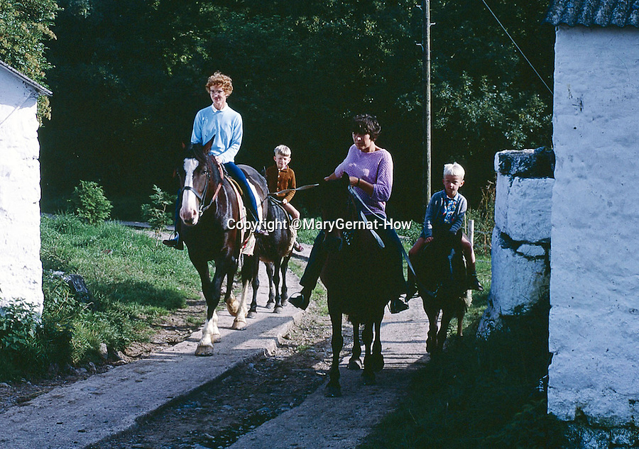 BNPS.co.uk (01202 558833)<br /> Pic: MaryGernat-How/BNPS<br /> <br /> ***Single Use - Not For Archive***<br /> <br /> Mary and two boys horseriding on holiday in the early 1960's.<br /> <br /> The real family behind Enid Blyton's iconic book covers has been revealed for the first time thanks to a hidden archive of sketches and family photos.<br /> <br /> Mary Gernat, who created the paperback covers for about 100 children's books in the 1960s, would get her young sons to stop mid-play and pose for her while she quickly sketched ideas for books like The Famous Five, the Secret Series, St Clare's and Malory Towers.<br /> <br /> Her son Roger How, 58, has now unveiled some of his mother's never-seen-before original sketches and finished book drafts which capture the classic images of childhood adventure he and his brothers helped create.