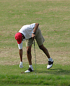 Kailua, Hawaii - December 29, 2008 -- United States President-elect Barack Obama replaces a divot while warming up on the driving range to play golf with friends in Kailua, Hawaii on Monday, December  29, 2008. Obama and his family arrived in his native Hawaii December 20 for the Christmas holiday..Credit: Joaquin Siopack - Pool via CNP