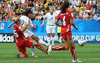 USA's Sydney Leroux (L) scores 2:0 against Danique Stein of Switzerland during the FIFA U20 Women's World Cup at the Rudolf Harbig Stadium in Dresden, Germany on July 17th, 2010.