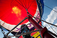 """Take Off 1"" - This photograph of a hot air balloon firing up and taking off was photographed at the 2011 Great Reno Balloon Race. Photographed from inside the hot air balloon basket."