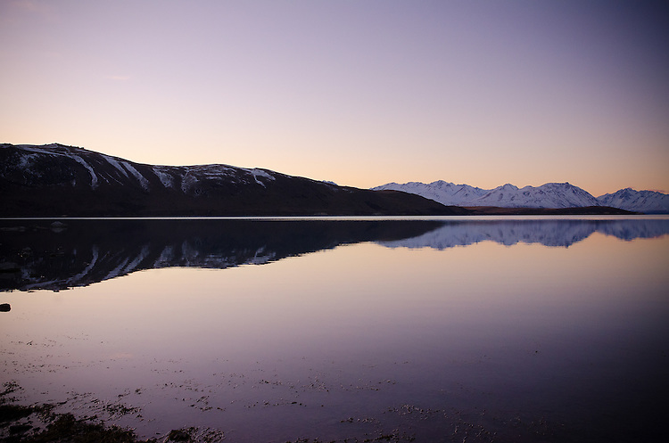 Twilight reflection of mountains and hills, Lake Tekapo, Mackenzie Country, New Zealand - stock photo, canvas, fine art print
