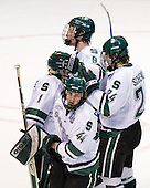 Mike Ratchuk (Michigan State - Buffalo, NY), Justin Abdelkader (Michigan State - Muskegon, MI) and Matt Schepke (Michigan State - Warren, MI) check in with Jeff Lerg (Michigan State - Livonia, MI) at the end of the first period. The Michigan State Spartans defeated the University of Maine Black Bears 4-2 in their 2007 Frozen Four semi-final on Thursday, April 5, 2007, at the Scottrade Center in St. Louis, Missouri.