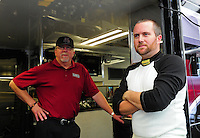 Jan. 17, 2012; Jupiter, FL, USA: NHRA top fuel dragster driver Shawn Langdon (right) with team owner Alan Johnson during testing at the PRO Winter Warmup at Palm Beach International Raceway. Mandatory Credit: Mark J. Rebilas-