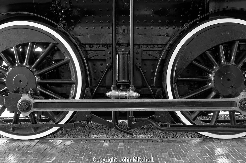 Close-up of the drive wheels  of the Restored CPR Engine 374 at the Roundhouse in Yaletown, Vancouver, British Columbia, Canada.