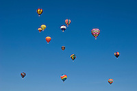 A hot air balloon consists of a bag called the envelope that is capable of containing heated air. Suspended beneath is the gondola or wicker basket (in some long-distance or high-altitude balloons, a capsule) which carries the passengers and a source of heat. The heated air inside the envelope makes it buoyant since it has a lower density than the relatively cold air outside the envelope. Unlike gas balloons, the envelope does not have to be sealed at the bottom since the air near the bottom of the envelope is at the same pressure as the surrounding air. In today's sport balloons the envelope is generally made from nylon fabric and the mouth of the balloon (closest to the burner flame) is made from fire resistant material such as Nomex.