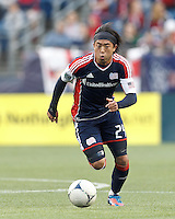 New England Revolution midfielder Lee Nguyen (24) brings the ball forward. In a Major League Soccer (MLS) match, the New England Revolution tied the Columbus Crew, 0-0, at Gillette Stadium on June 16, 2012.