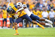Landover, MD - SEPT 24, 2016: West Virginia Mountaineers wide receiver Shelton Gibson (1) is tackled after a big third down catch to move the chains during their match up at FedEx Field in Landover, MD. (Photo by Phil Peters/Media Images International)