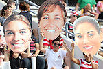 10 November 2013: U.S. fans hold up cutouts of players Alex Morgan (left), Abby Wambach, and Hope Solo (right). The United States Women's National Team played the Brazil Women's National Team at the Citrus Bowl in Orlando, Florida in an international friendly soccer match.