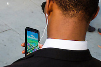 "NEW YORK, NY - JULY 24 : A man plays the augmented reality mobile game ""Pokemon Go"" by Nintendo on July 24, 2016 in Manhattan, New York. Photo by VIEWpress"