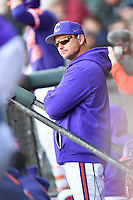 Head coach Monte Lee of the Clemson Tigers watches the action in the Reedy River Rivalry game against the South Carolina Gamecocks on Saturday, March 4, 2017, at Fluor Field at the West End in Greenville, South Carolina. Clemson won, 8-7. (Tom Priddy/Four Seam Images)