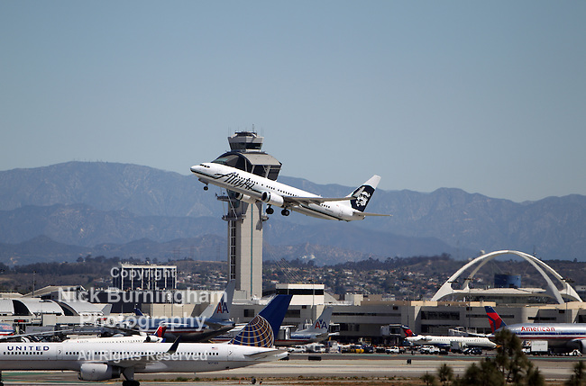 LOS ANGELES, CALIFORNIA, USA - April 17, 2013 - Alaska Airlines Boeing 737-890 takes off from Los Angeles Airport on April 17, 2013. The plane has a range of 5,765 km and a maximum speed of 544 mph