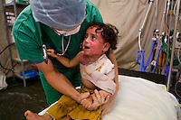 Gaza city, Jan 27 2009..Eshgen Karabi, 2, has 2nd degree burns on the face, the neck and the upper torso as the result of the shelling of her house by the Israeli army. She is one the first patients to benefit from the new inflatable medical structures erected by MSF late last week in Gaza City. The two hospital tents include operating theaters and a 12-bed post-surgery recovery and post-operative care unit.