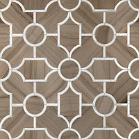 Chatham 3, a waterjet stone mosaic, shown in Driftwood and Calacatta Tia honed.