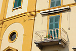 Bright and colorful windows on a building in Varenna, a town on Lake Como, Italy.