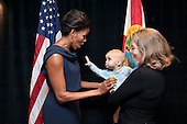 "A child reaches out to First Lady Michelle Obama prior to a Faith and Community Groups Leading the Way event at Northland, A Church Distributed, in Longwood, Florida, February 11, 2012. The event was held  in celebration of the second anniversary of the ""Let's Move!"" initiative.Mandatory Credit: Chuck Kennedy - White House via CNP"
