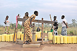 Women in Yei, Southern Sudan, getting water from a well provided by the United Methodist Committee on Relief (UMCOR).