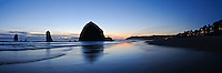 Haystack Rock mirrored in sand, Cannon Beach, Oregon, USA