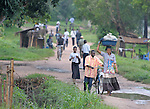 People walking along a street in the Congolese town of Kananga.