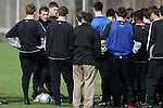 08 December 2005: Maryland head coach Sasho Cirovski (2nd from left) talks to his team during a practice session at SAS Stadium in Cary, North Carolina in preparation for the NCAA Men's Division I College Cup semifinals to be played the following day.