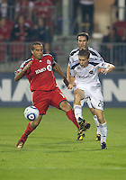 26 June 2010: Toronto FC forward Dwayne De Rosario #14 and Los Angeles Galaxy midfielder Michael Stephens #26 in action during a game between the Los Angeles Galaxy and the Toronto FC at BMO Field in Toronto..Final score was 0-0...