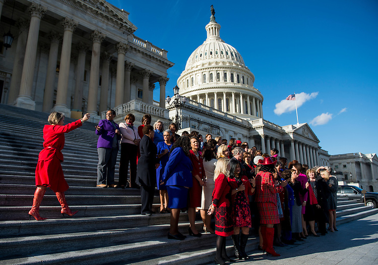 UNITED STATES - JANUARY 4: Rep. Michelle Lujan Grisham, D-N.M., left, arrives for the photo-op on the House steps with House Minority Leader Nancy Pelosi, D-Calif., and the other Democratic women on Wednesday, Jan. 4, 2017, to highlight the historic swearing-in of 65 House Democratic women to the 115th Congress. (Photo By Bill Clark/CQ Roll Call)