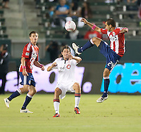 CARSON, CA – OCTOBER 9: Toronto FC defender Nick Garcia (4) and Chivas USA midfielder Rodolfo Espinoza (24) during a soccer match at Home Depot Center, October 9, 2010 in Carson California. Final score Chivas USA 3, Toronto FC 0.