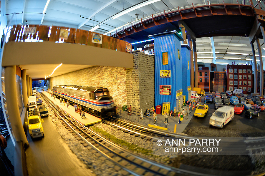 Farmingdale, New York, USA. November 26, 2016.  An Amtrak model train speeds through a tunnel at the Train Masters of Babylon TMB Model Train Club's Open House. Visitors enjoy a 4000 square foot O Gauge model railroad with 10 trains running on 19 scale miles of track and an underground subway system. Watching O Scale model trains traveling on tracks through various elaborate scenes was family fun, free and open to the public, during the long Thanksgiving holiday weekend.