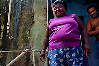 A Brazilian woman stands in the door of her humble house in Rocinha, the largest slum in Rio de Janeiro, 28 February 2004.