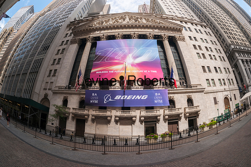A banner for the Boeing Company decorates the front of the New York Stock Exchange in New York on Friday, July 15, 2016. The aeronautics company is celebrating 100 years of its existence since it was founded in Seattle by Bill Boeing.  (© Richard B. Levine)