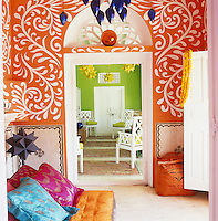 The floral motifs on the wall of the meditation room were created by Nicholas Alvis Vega